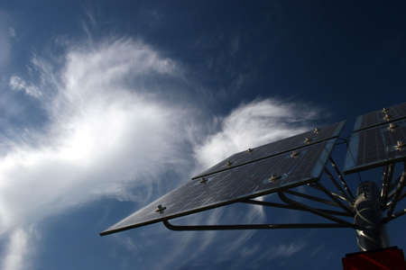 cirrus: Solar panels in front of bizarre cirrus clouds Stock Photo