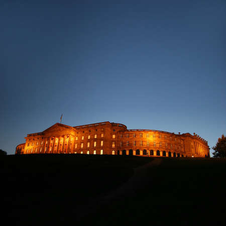 The illuminated castle of Wilhelmshoehe in the mountain park seen during the sunset, Kassel/Germany
