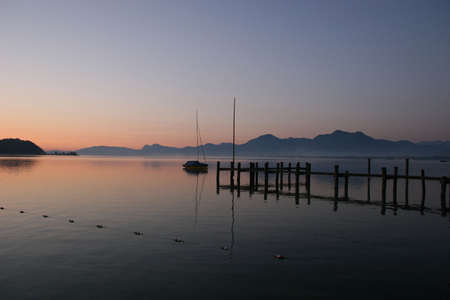 Lake Chiemsee in front of the german Alps photo