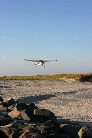 puffy: Starting airplane seen at the airfield of the german island Helgoland D�ne Stock Photo