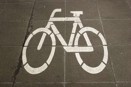 Sign of a bike at a bicycle lane photo