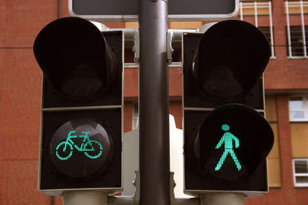 Green bicycle and pedestrian traffic lights, seen in Braunschweig, Germany