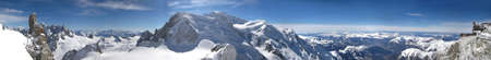 Panoramic picture of Mont Blanc, french Alps. With 4808 meters its the highest alpine peak, seen from the Aiguille du Midi cable car station (3842 m). Stock Photo