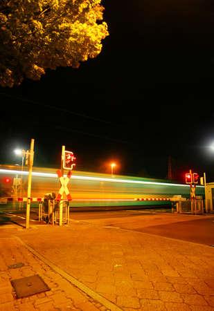 Railroad crossing at night of a Metro (U-Bahn) in Bad Homburg Ober-Eschbach near Frankfurt, Germany photo