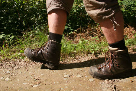 Legs with hiking boots of a wanderer in the german Sauerland mountains Stock Photo