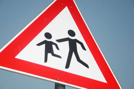 Warning sign of playing childs near a school photo
