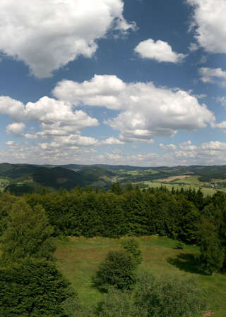 German Hochsauerland mountains (with mount Kahler Asten and others). Picture was made from the holy mountain Wilzenberg near Schmallenberg/Grafschaft. In the middle the valley Lennetal.
