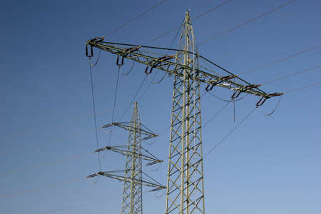 Power line in front of blue sky photo