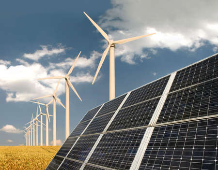 solar electric: Solar panels in front of wind energy plants and wheat field