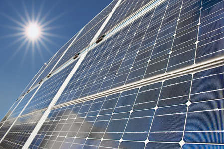 Solar panels with shafts of sunlight