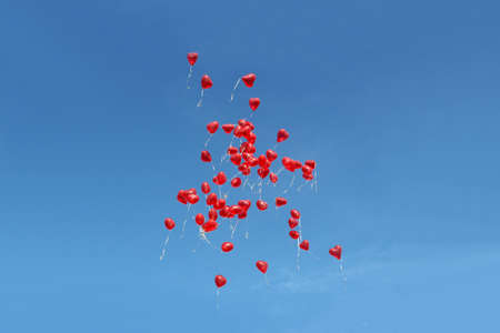 ballon: Many red balloons in front of blue sky Stock Photo