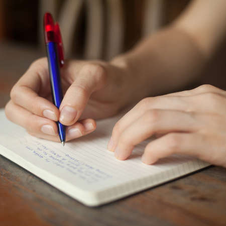 creative writer: Abstract hands writing on the paper