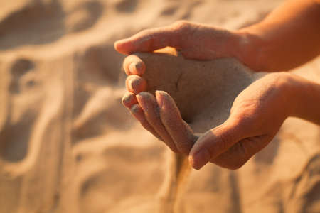 useless: time passing, sand in the hands