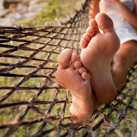 perezoso: relajarse en una hamaca, vacaciones perezosas