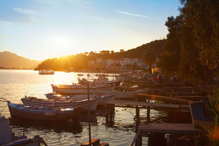 poros: boats at sunset, beautiful view of Poros island in Greece Stock Photo