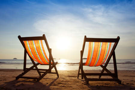 beach chairs: inviting deckchairs on the beach Stock Photo
