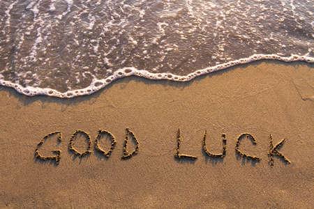 buena suerte: Buena suerte, las palabras escritas en la playa