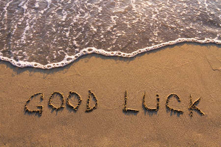 good luck, words written on the beach Banco de Imagens