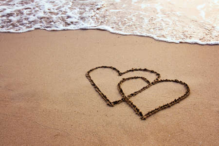 interlocked: valentines, two hearts on the beach