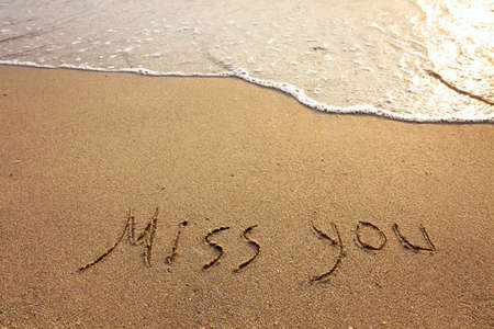 miss you: miss you, words on the sand Stock Photo