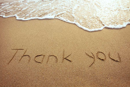 sand writing: thank you, word drawn on the beach Stock Photo