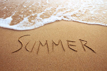 sand writing: summer, word drawn on the beach