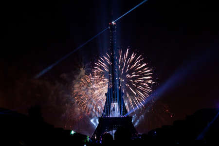 PARIS - JULY 14: night scene of  fireworks at Eiffel Tower in Bastille Day,  July 14, 2013 in Paris France photo