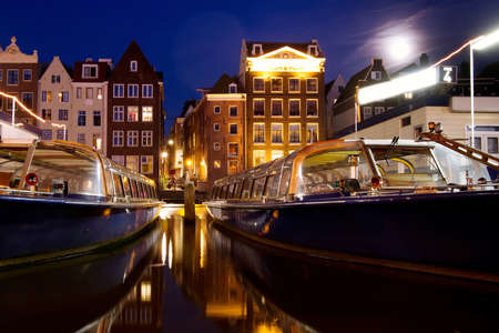 night scene from Amsterdam, boats and houses, Netherlands photo