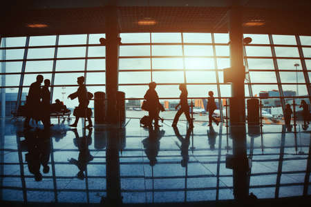 business travel, silhouettes of walking people in the airport Stok Fotoğraf
