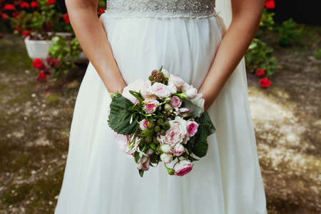 bride with wedding bouquet in hands photo