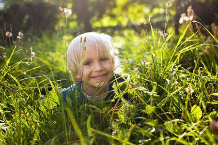 blond boy: blond happy little boy in the grass