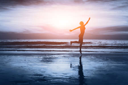 healthy life, silhouette of carefree woman on the beach