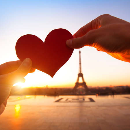 ladies day: heart in hands, loving couple in Paris, France
