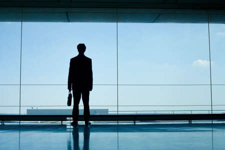 office man: silhouette of businessman in office interior