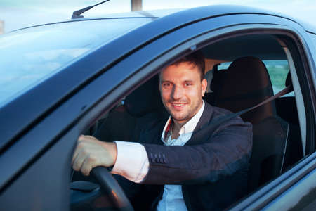 rent a car, smiling happy caucasian young man driving Stock Photo