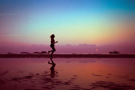 wellbeing or sport background, woman silhouette on the beach