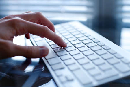 internet keyboard: working on computer, close up of hand on keyboard Stock Photo