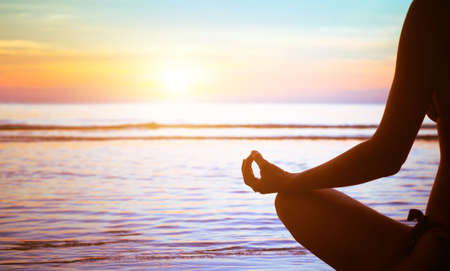 meditation concept, yoga practice on the beach at sunset Imagens - 53072397
