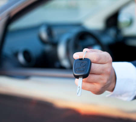 car keys in the hand, rent or buy car