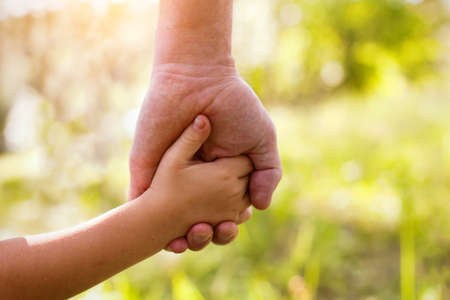 father and son holding hands: father and child Stock Photo