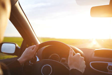 trips: driving car on the empty road, travel background Stock Photo