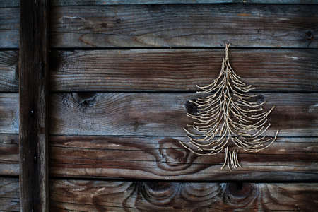 tinkering: christmas tree on wooden background, new year card Stock Photo