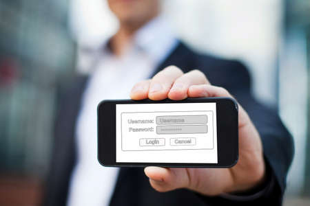hidden danger: internet security concept, login page on the screen of mobile phone Stock Photo