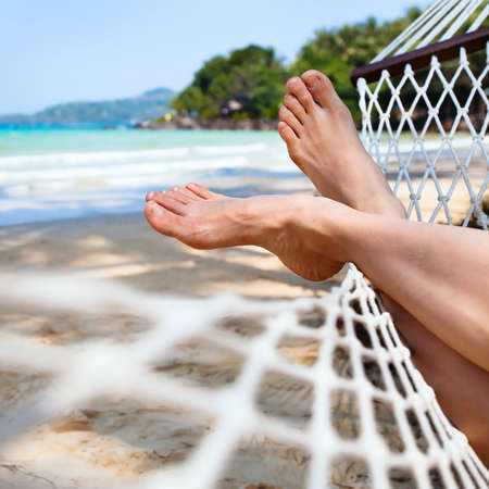 travel woman: relax in hammock on the beach