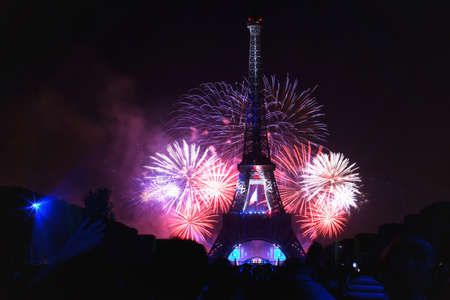 14: PARIS - JULY 14: night scene of fireworks at Eiffel Tower in Bastille Day, National Day of France, July 14, 2013 in Paris France Stock Photo