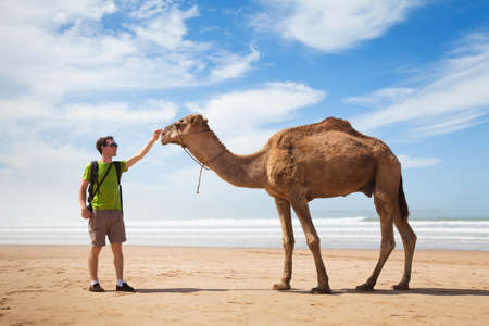 two men: camel and tourist