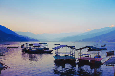 phewa: beautiful awesome sunset over Phewa lake, Pokhara, Nepal
