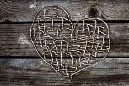 tinkering: heart on wooden background