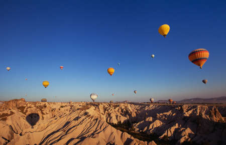 beautiful landscape with hot air balloons and mountains in Cappadocia, Turkey