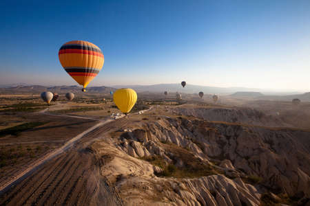 inspiring beautiful landscape with hot air balloons Stock Photo